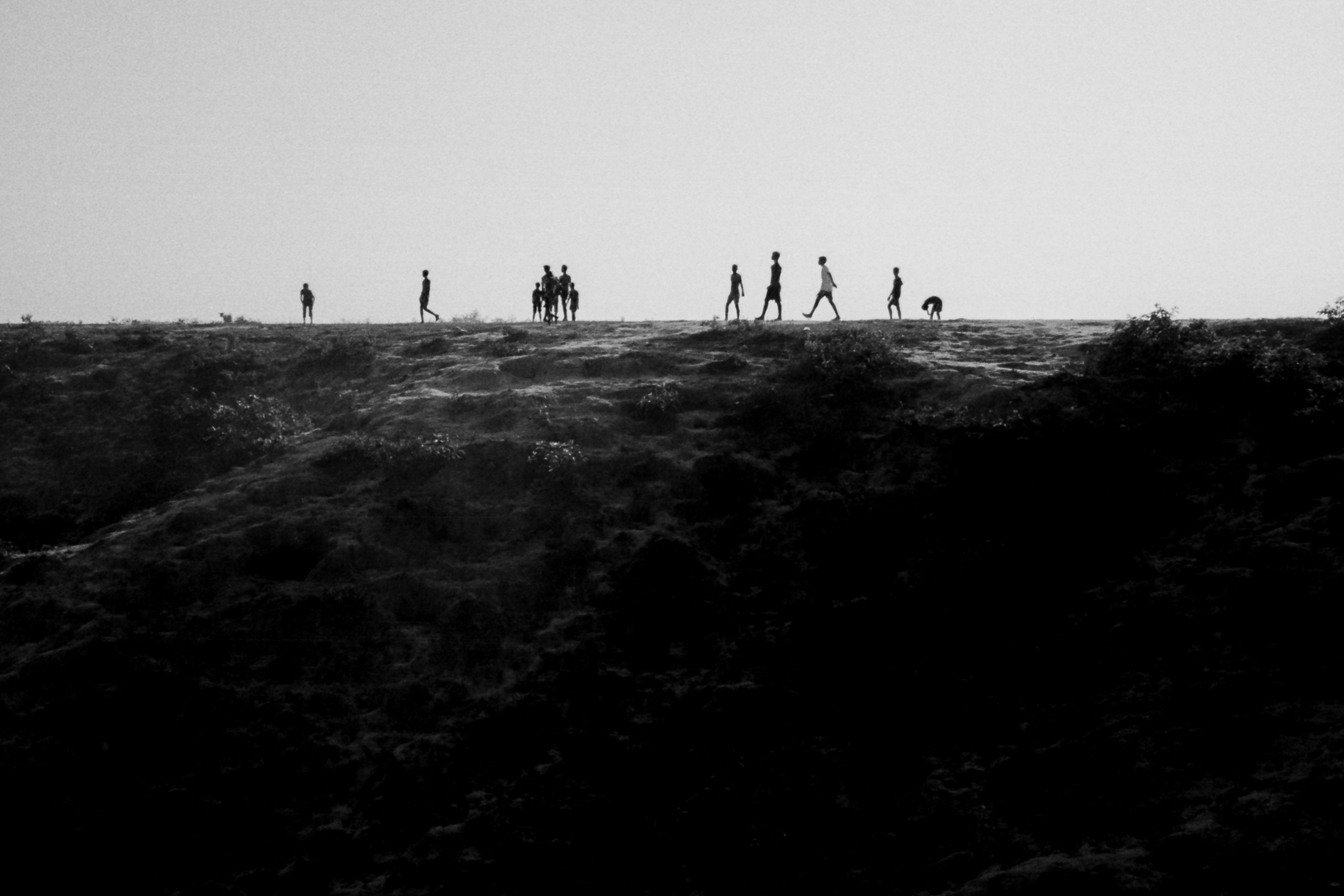 Children walk along a ridge above Kutupalong makeshift refugee camp.  Ukiyah, Bangladesh.